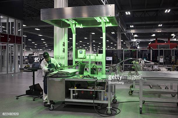 An employee sands down a body panel for a Honda Motor Co 2017 Acura NSX vehicle at the Honda Performance Manufacturing Center in Marysville Ohio US...