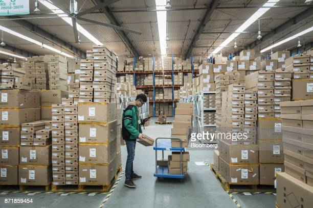 An employee scans a box at Best Inc's warehouse in Shanghai China on Monday Nov 6 2017 Best the Chinese logistics provider backed by Alibaba Group...
