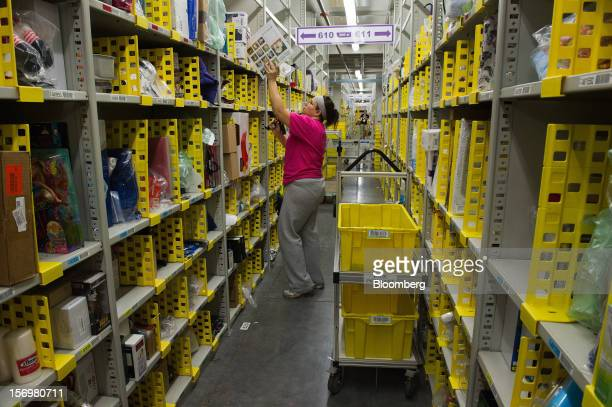 An employee scans an item that will be shipped from the Amazoncom Inc distribution center in Phoenix Arizona US on Monday Nov 26 2012 US retailers...
