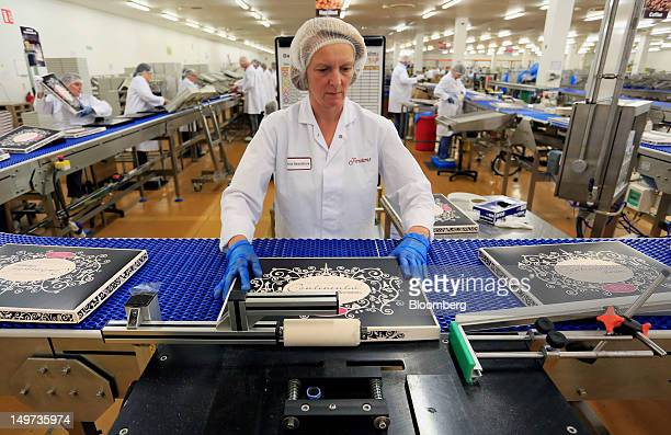 An employee seals a Thorntons Continental chocolate box on the packaging line at the Thorntons Plc factory in Alfreton UK on Thursday Aug 2 2012 The...