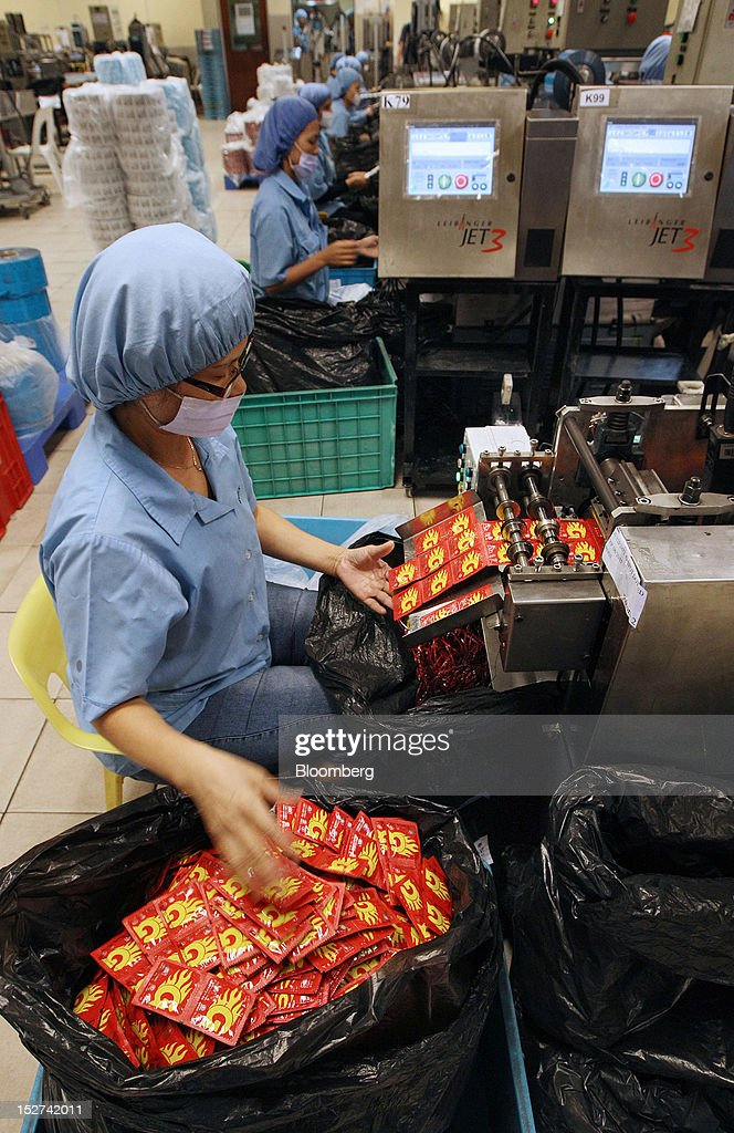 An employee separates sealed packets of condoms for packaging at the Karex Industries Sdn. Bhd. condom factory in Pontian Besar, Johor, Malaysia, on Thursday, Sept. 20, 2012. Karex Industries' line of business includes the manufacturing of industrial rubber goods, rubberized fabrics, and miscellaneous rubber specialties. Photographer: Goh Seng Chong/Bloomberg via Getty Images