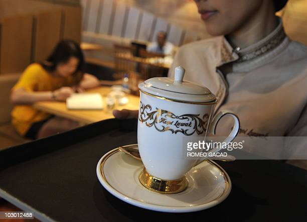 An employee serves an 80000 rupiah cup of Kopi Luwak at a local coffee shop in Jakarta on July 20 2010 serving the world's priciest and rarest coffee...