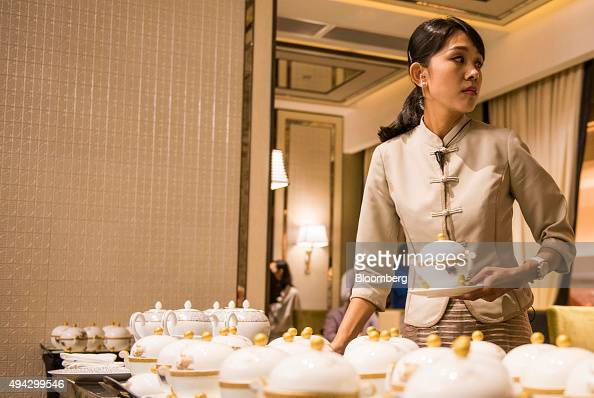 An employee serves soup at the Pearl Dragon Chinese restaurant at the Studio City casino resort developed by Melco Crown Entertainment Ltd ahead of...