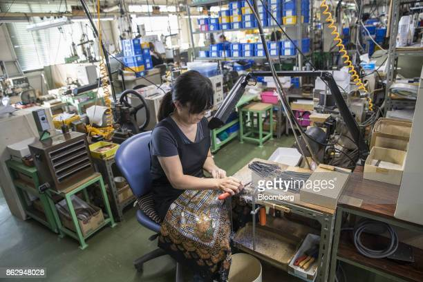 An employee shapes an eyeglass temple at a Nagai Co factory in Sabae Fukui Prefecture Japan on Tuesday Oct 10 2017 Fukui Prefecture has one of the...