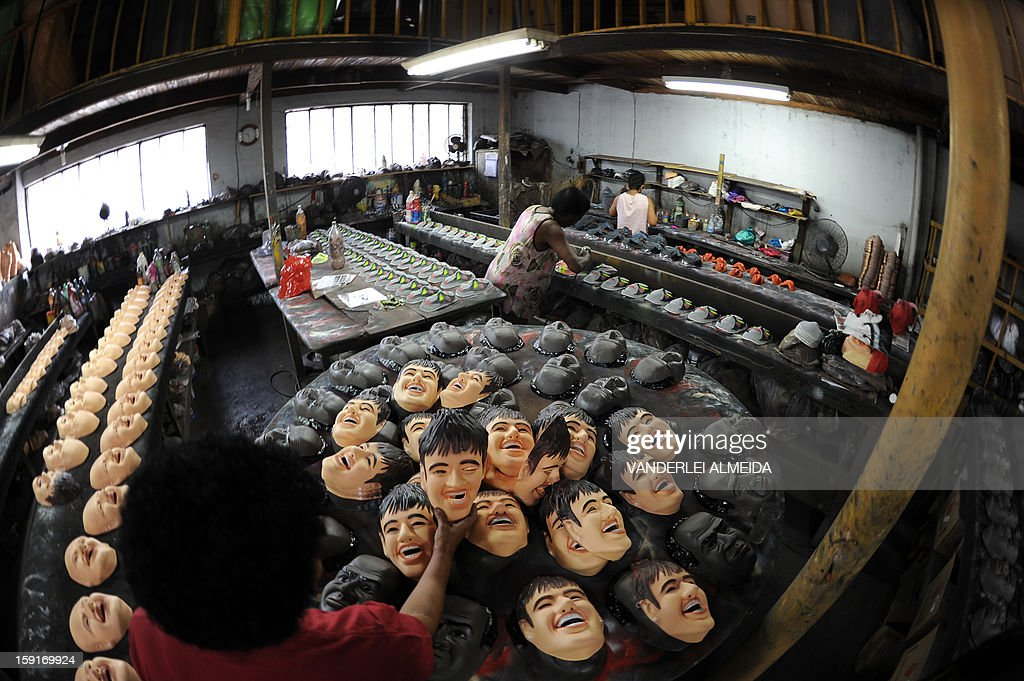 An employee shows a mask of Brazilian football star Neymar, at the carnival masks factory Condal, in Sao Gonçalo, about 35 km from downtown Rio de Janeiro, on January 9, 2013. Rio's world famous carnival takes place February 9-12.