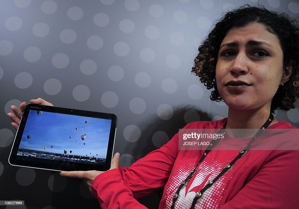 An employee shows a new Motorola Mobility Holdings Inc. Xoom tablet at the 3GSM World congress in Barcelona, on February 17, 2011. The 2011 Mobile World Congress is held 14-17 February, in Barcelona.