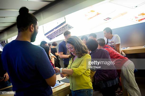 An employee shows the Apple Watch at the Apple Store June 17 2015 on Fifth Avenue in New York City The company began selling the watch in stores...
