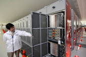 An employee shows the inside of a Fujitsu Ltd K supercomputer at Riken Kobe Institute in Kobe City Hyogo Prefecture Japan on Wednesday Nov 9 2011...
