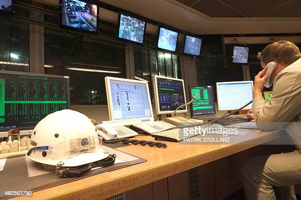 An employee sist in the controlroom at the blast furnace at the ThyssenKrupp steel mill Hamborn on December 12 2014 in Duisburg western Germany AFP...