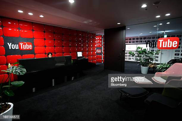 An employee sits behind the reception desk at Google Inc's YouTube Space studio in Tokyo Japan on Saturday March 30 2013 In Japan YouTube's biggest...