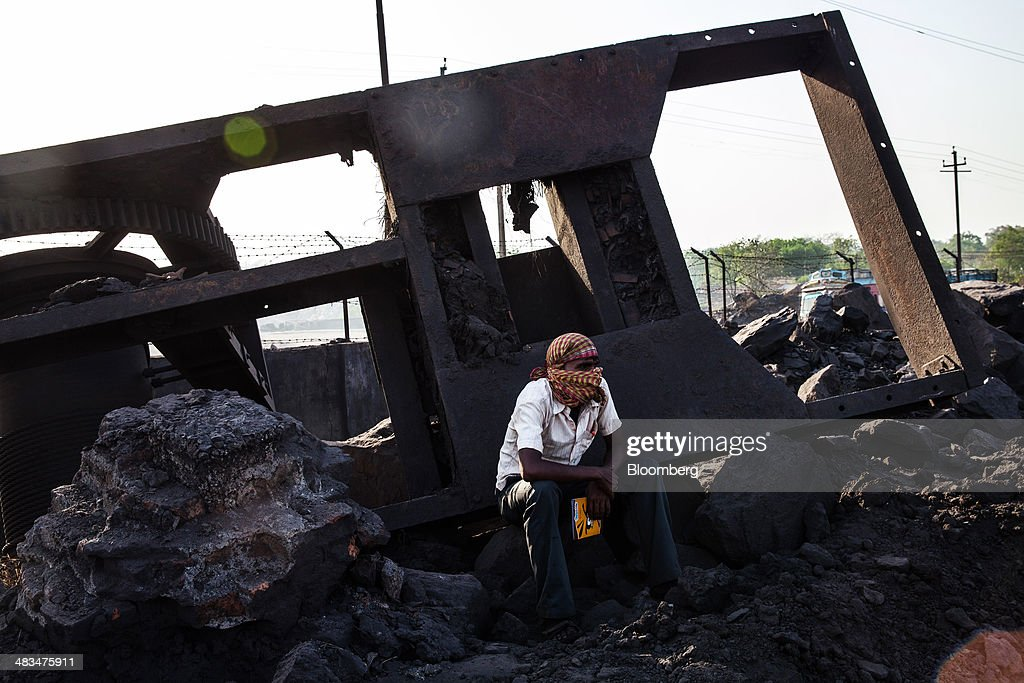 An employee sits down during a break at a coal depot, operated by Coal India Ltd. subsidiary Bharat Coking Coal Ltd. (BCCL), in Jharia, Jharkhand, India, on Sunday, April 6, 2014. Coal India, the worlds largest producer, estimates on its website that the nation faces a supply deficit of 350 million tons by 2016-2017, thereby overtaking import demand from China, the worlds biggest coal consumer and producer. Photographer: Sanjit Das/Bloomberg via Getty Images