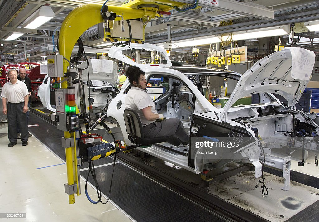 An employee sits on an hydraulically operated chair as Adam Opel AG automobiles move along the production line at the Opel factory, operated by General Motors Co. (GM), in Eisenach, Germany, on Wednesday, April 23, 2014. European sales at Opel and its U.K. sister brand Vauxhall gained 8.5 percent to 226,888 cars in the first quarter, slightly better than the 8.1 percent increase for the market overall, according to ACEA data. Photographer: Martin Leissl/Bloomberg via Getty Images