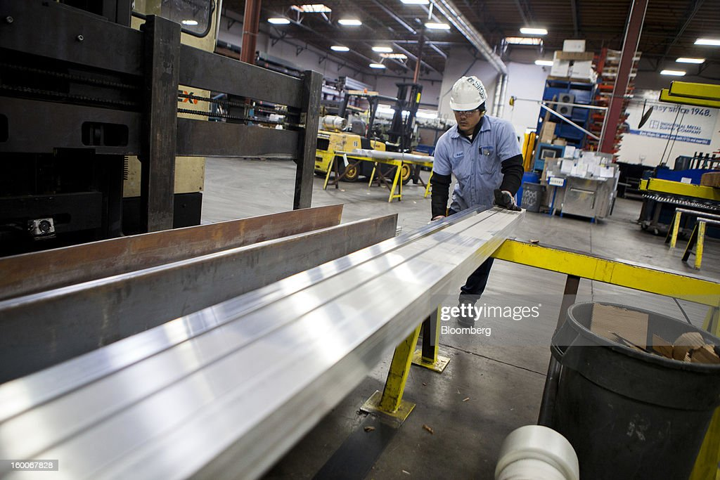 An employee sorts aluminum at Industrial Metal Supply Co.'s warehouse in San Diego, California, U.S., on Thursday, Jan. 24, 2013. Industrial Metal Supply Co. is an aluminum, steel and sheet metal supplier serving businesses and retail custmers. Photographer: Sam Hodgson/Bloomberg via Getty Images