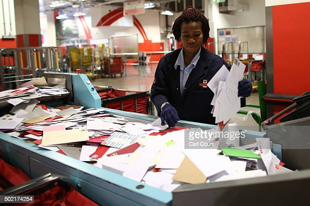 An employee sorts deliveries at Royal Mail's Mount Pleasant Mail Centre on December 21 2015 in London England This week is expected to be the busiest...