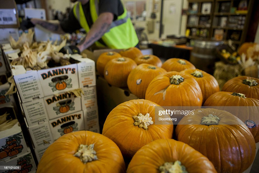 An employee sorts pumpkins at the Specialty Produce warehouse in San Diego, California, U.S., on Friday, Nov. 1, 2013. The U.S. Bureau of Economic Analysis is scheduled to release gross domestic product (GDP) figures on Nov. 7. Photographer: Sam Hodgson/Bloomberg via Getty Images
