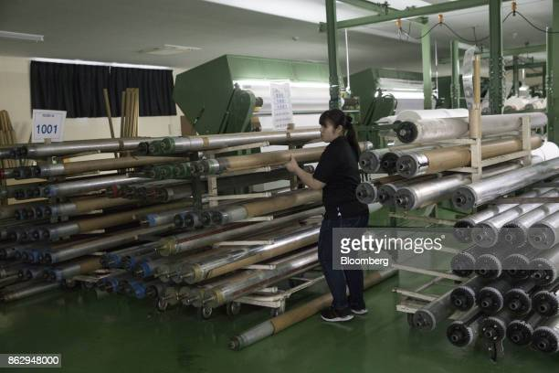An employee sorts rods at a Hironen Textile Industry Co factory in Sakai Fukui prefecture Japan on Tuesday Oct 10 2017 Fukui Prefecture has one of...