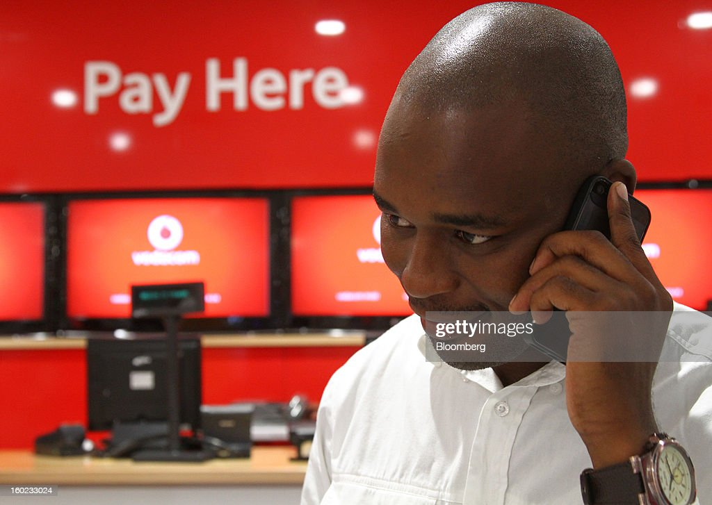 An employee speaks on a mobile phone in the offices of Vodaworld, the headquarters of Vodacom Group Ltd., Vodafone's biggest African business, in Johannesburg, South Africa, on Monday, January 28, 2013. Almost two decades after Vodafone Group Plc entered Africa, the region -- where most people earn less than $2 a day and mobile phone towers run on diesel -- is turning into one of the company's biggest profit generators. Photographer: Nadine Hutton/Bloomberg via Getty Images