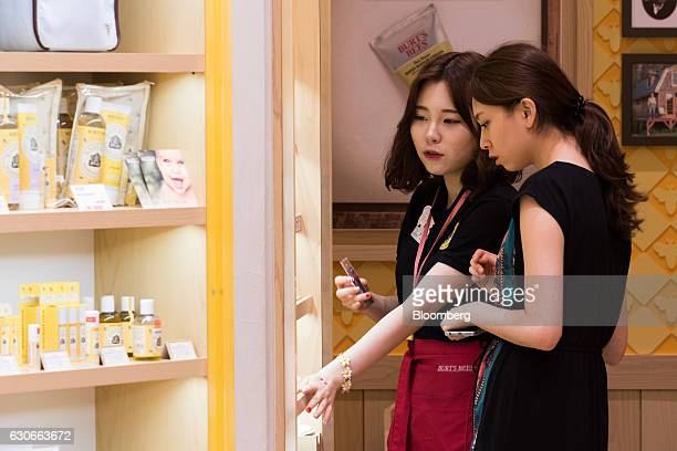 An employee speaks with a customer at a Burt's Bees Inc store a subsidiary of Clorax Co in Seoul South Korea on Thursday July 2 2015 At a time when...