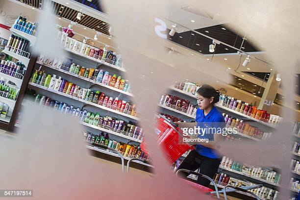 An employee stacks baskets at a Sansar Supermarket in Ulaanbaatar Mongolia on Wednesday July 13 2016 The nation's growth slowed to 23 percent last...