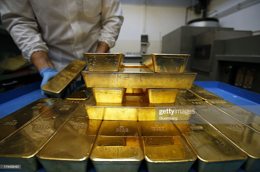 An employee stacks gold bars bearing the hallmark of Chimet SpA, the Italian goldsmith company onto a cart inside the precious metals refinery plant of Italpreziosi SpA in Arezzo, Italy, on Friday, July 19, 2013. Hedge funds raised bets on a gold rally before prices capped the biggest two-week gain in 20 months as Federal Reserve Chairman Ben S. Bernanke damped speculation that a cut in stimulus is imminent. Photographer: Alessia Pierdomenico/Bloomberg via Getty Images