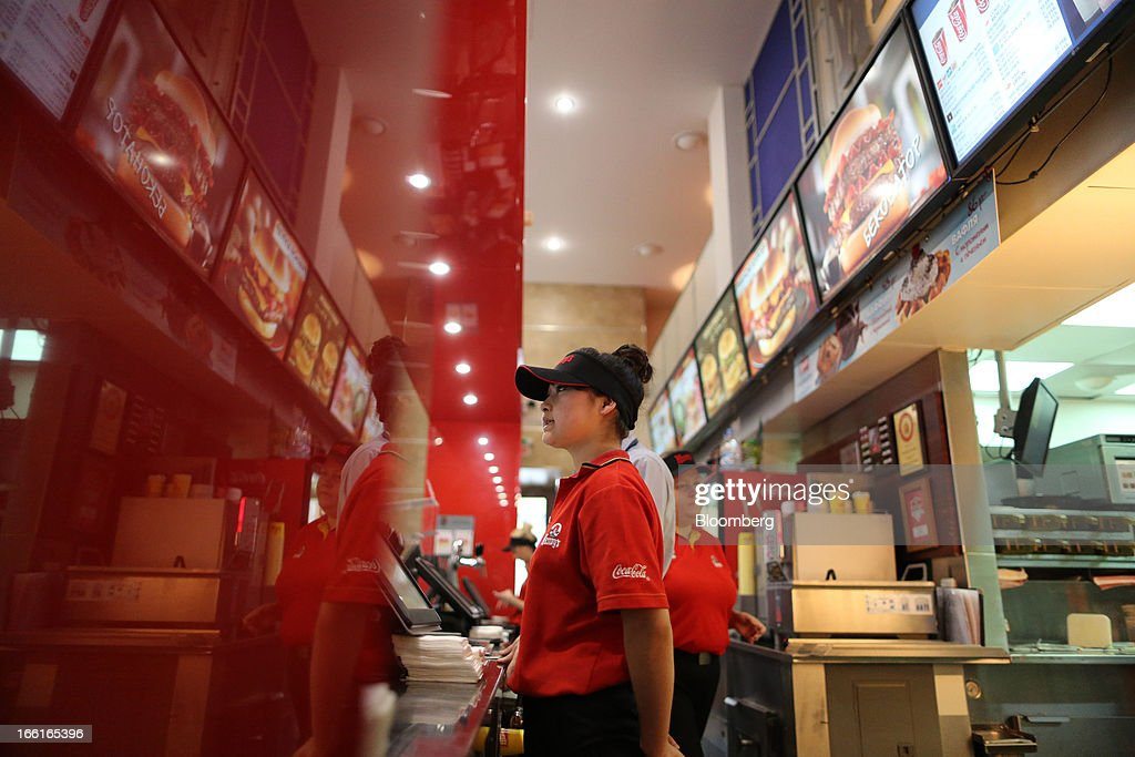 An employee stands and waits to serve customers behind the service counter of a Wendy's fast food restaurant in Moscow, Russia, on Friday, April 5, 2013. McDonald's, which virtually created the market for burgers and fries in the country and convinced Russians it's OK to eat with their hands, must fend off a growing challenge from rivals Burger King Worldwide Inc., Subway Restaurants, Yum! Brands Inc. and Wendy's Co. Photographer: Andrey Rudakov/Bloomberg via Getty Images
