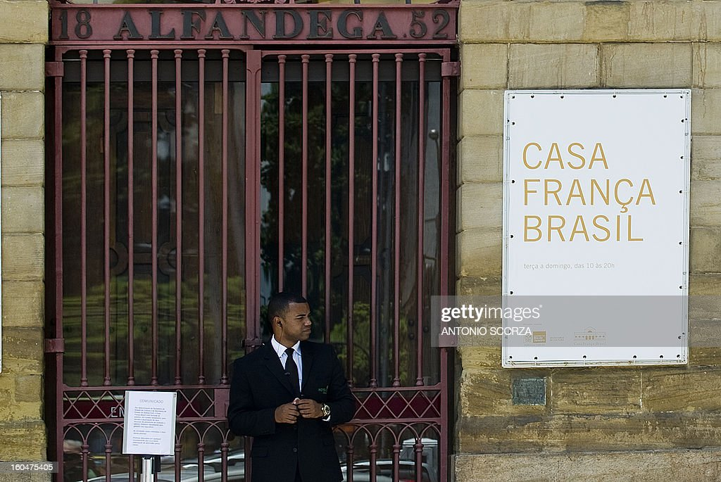 An employee stands at the entrance of the France-Brazil Cultural Centre, closed by the Civil Defence Secretary on February 1, 2013 in Rio de Janeiro, Brazil. Ensueing the fire at the Kiss nightclub in Santa Maria that killed 236 people, Rio's government closed 49 theaters, cultural centers and local restaurants not compliant with the safety regulations.