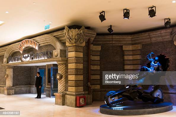 An employee stands at the entrance to the Batman Dark Flight attraction in the Studio City casino resort developed by Melco Crown Entertainment Ltd...