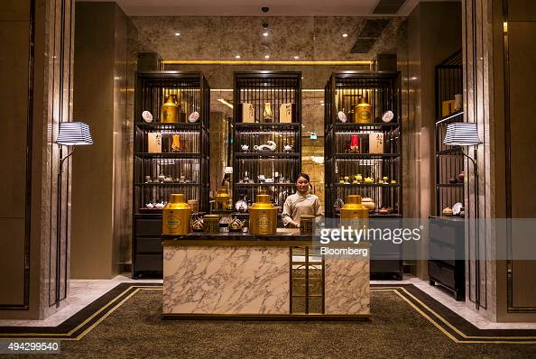 An employee stands at the tea counter of the Pearl Dragon Chinese restaurant at the Studio City casino resort developed by Melco Crown Entertainment...