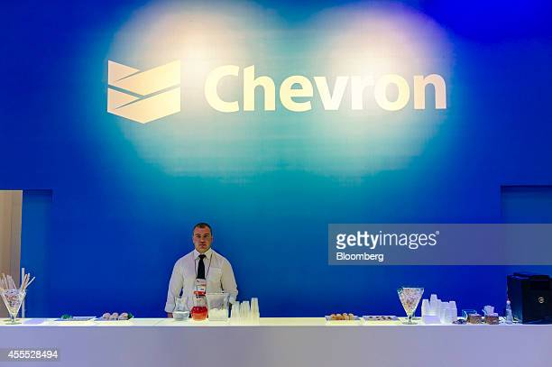 An employee stands behind a service bar at the Chevron Corp trade stand during the Rio Oil Gas 2014 Expo and Conference in Rio de Janeiro Brazil on...