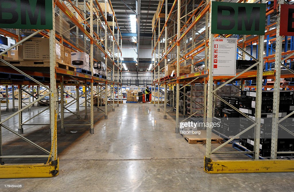 An employee stands between rows of shelves storing merchandise at the Myer Holdings Ltd. distribution center in Melbourne, Australia, on Tuesday, Sept. 3, 2013. A Bureau of Statistics report released in Sydney on Sept. 4 showed household spending climbed 0.4 percent in the second quarter, adding 0.2 percentage point to gross domestic product growth. Photographer: Carla Gottgens/Bloomberg via Getty Images