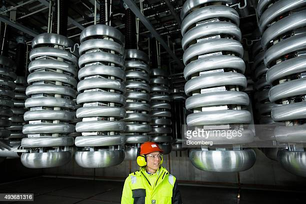An employee stands in an electricity current converter room aboard the Troll A natural gas platform operated by Statoil ASA in the North Sea Norway...