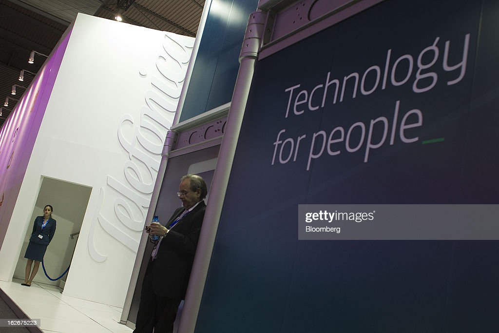 An employee stands in the doorway of an entrance point to the Telefonica SA pavilion at the Mobile World Congress in Barcelona, Spain, on Monday, Feb. 25, 2013. The Mobile World Congress, where 1,500 exhibitors converge to discuss the future of wireless communication, is a global showcase for the mobile technology industry and runs from Feb. 25 through Feb. 28. Photographer: Angel Navarrete/Bloomberg via Getty Images