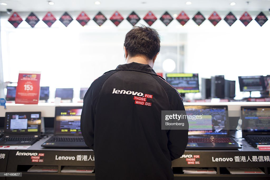 An employee stands inside a Lenovo Group Ltd. store in the Sha Tin district of Hong Kong, China, on Friday, Feb. 7, 2014. Lenovo, which has headquarters in Beijing and Morrisville, North Carolina, agreed to pay $2.3 billion for IBMs low-end server unit on Jan. 23, adding a business with wider profit margins than PCs and giving it about 14 percent of the market. Photographer: Brent Lewin/Bloomberg via Getty Images