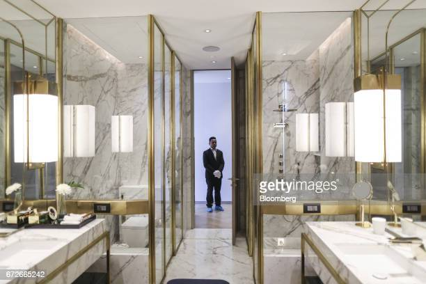 An employee stands inside a show home at Lodha Altamount a luxury residential project developed by Lodha Developers Ltd in Mumbai India on Monday...
