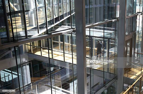 An employee stands on an elevated walkway in the Baidu Inc headquarters in Beijing China on Wednesday Nov 12 2014 While Beijingbased Baidu owner of...