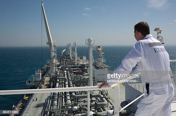 An employee stands on the Expedient regasification ship anchored off the coast of Israel in the Mediterranean Sea on February 26 as natural gas began...