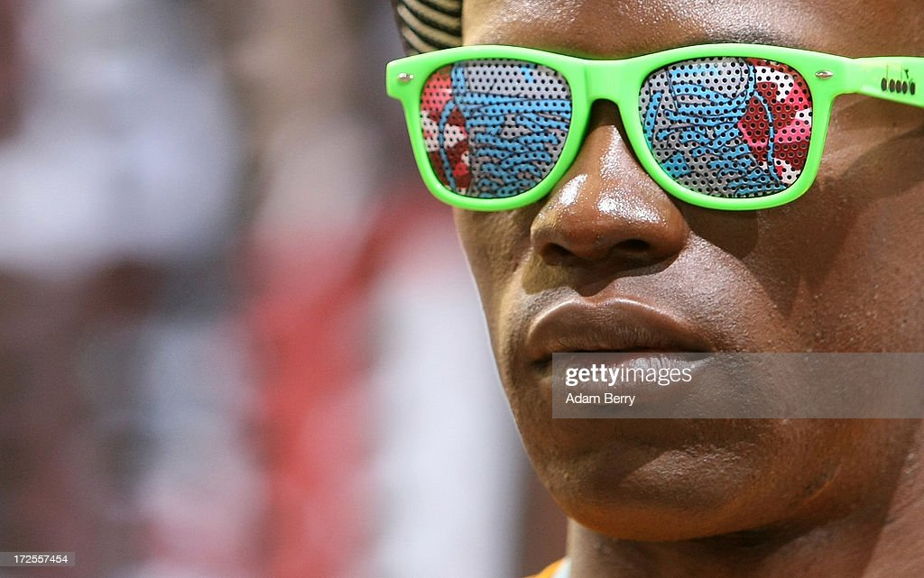 An employee stands wearing sunglasses at the Diadora stand during the Bread and Butter trade show at the former Tempelhof airport during Mercedes-Benz Fashion Week in Berlin on July 3, 2013 in Berlin, Germany.
