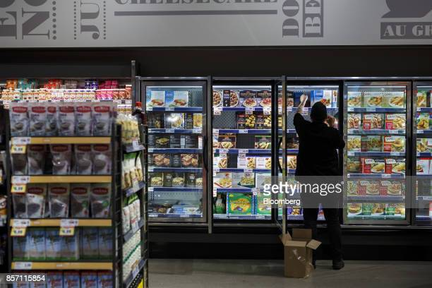 An employee stocks a freezer inside a Metro Inc grocery store in Toronto Ontario Canada on Monday Oct 2 2017 Canadian grocer Metro Inc agreed to buy...