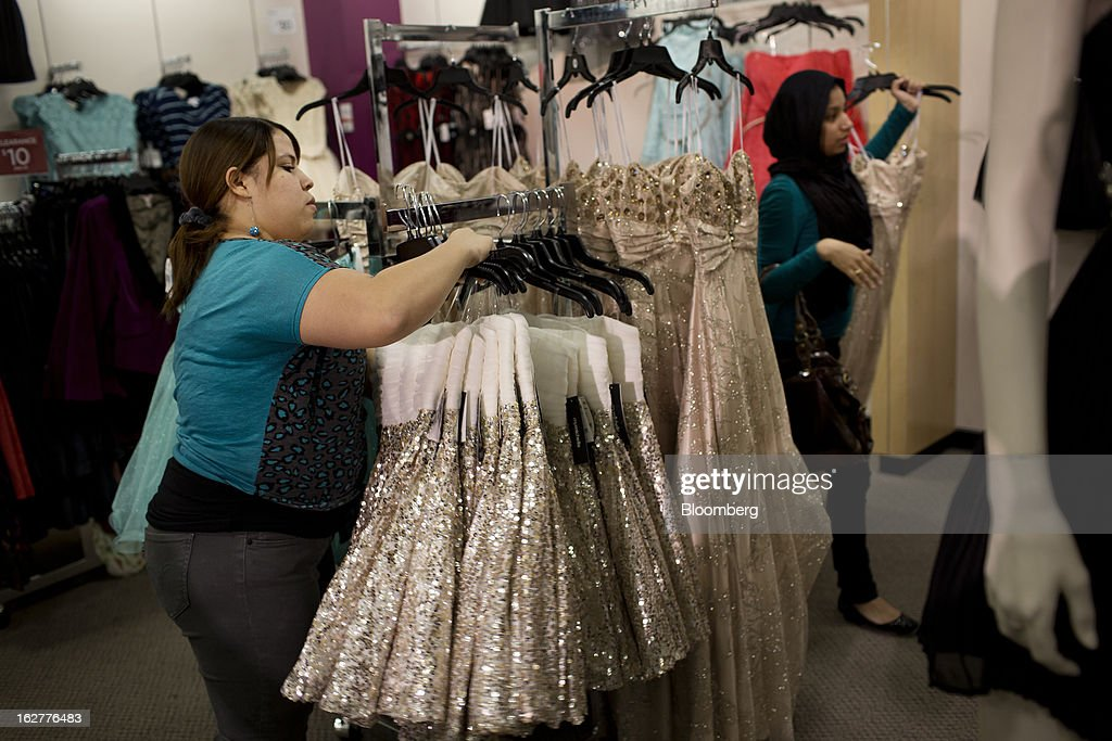 An employee stocks a rack with dresses at a J.C. Penney Co. store in the Queens borough of New York, U.S., on Tuesday, Feb. 26, 2013. Confidence among U.S. consumers jumped more than forecast in February as Americans adjusted to a higher payroll tax and signs of a recovering housing market spurred faith in the future. J.C. Penney Co. is scheduled to release earnings data on Feb. 27. Photographer: Victor J. Blue/Bloomberg via Getty Images