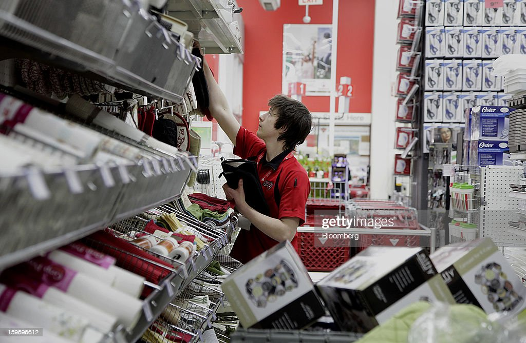 An employee stocks shelves at a Canadian Tire Corp. store in Toronto, Ontario, Canada, on Friday, Jan. 18, 2013. STCA - Statistics Canada is scheduled to release retail sales data on Jan. 21. Photographer: Reynard Li/Bloomberg via Getty Images