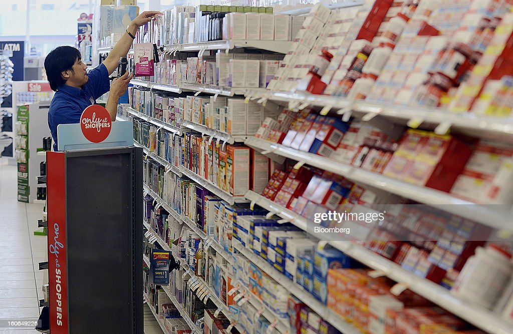 An employee stocks shelves at a Shoppers Drug Mart Corp. store in Toronto, Ontario, Canada, on Monday, Feb. 4, 2013. Shoppers Drug Mart Corp., Canada's largest pharmacy chain, is scheduled to release earnings data on Feb. 7. Photographer: Aaron Harris/Bloomberg via Getty Images