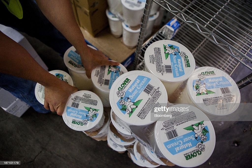 An employee stocks sour cream at the Specialty Produce warehouse in San Diego, California, U.S., on Friday, Nov. 1, 2013. The U.S. Bureau of Economic Analysis is scheduled to release gross domestic product (GDP) figures on Nov. 7. Photographer: Sam Hodgson/Bloomberg via Getty Images