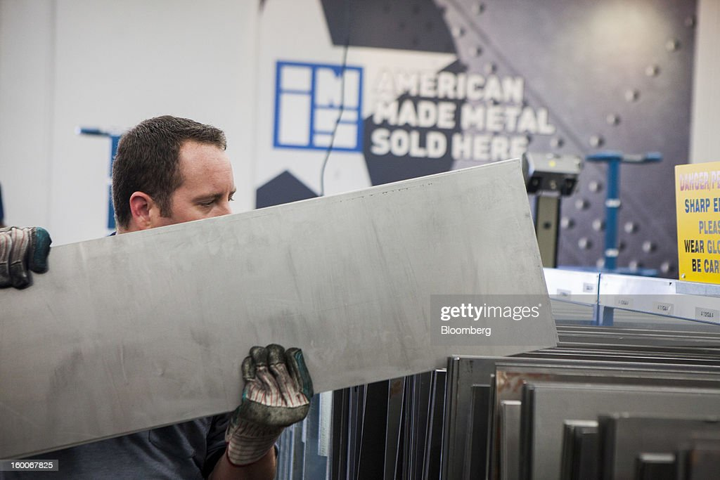 An employee stocks steel sheets at Industrial Metal Supply Co.'s store in San Diego, California, U.S., on Thursday, Jan. 24, 2013. Industrial Metal Supply Co. is an aluminum, steel and sheet metal supplier serving businesses and retail custmers. Photographer: Sam Hodgson/Bloomberg via Getty Images
