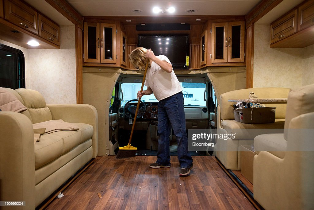 An employee sweeps the floors of a Class C motorhome at Nexus RV in Elkhart, Indiana, U.S., on Friday, Feb. 8, 2013. Orders placed with U.S. factories increased less than forecast in December, reflecting a drop in non-durable goods that partly countered gains in construction equipment and computers. Photographer: Ty Wright/Bloomberg via Getty Images