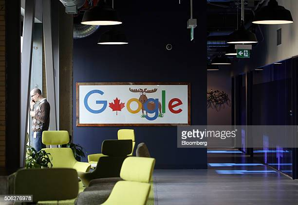 An employee talks on a mobile phone at Google Canada's engineering headquarters in Waterloo Ontario Canada on Friday Jan 22 2016 The 185000squarefoot...