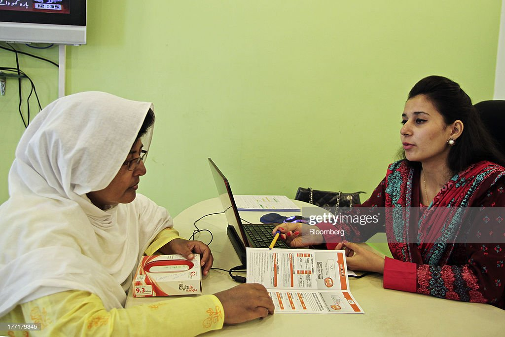 An employee talks to a customer at the Pakistan Telecommunications Co. (PTCL) sales and customer care center in Islamabad, Pakistan, on Wednesday, Aug. 21, 2013. Pakistan Telecommunication, the countrys biggest fixed-line phone-service provider, said second-half sales growth will at least match the pace of the previous six months as broadband demand increases. Photographer: Asad Zaidi/Bloomberg via Getty Images