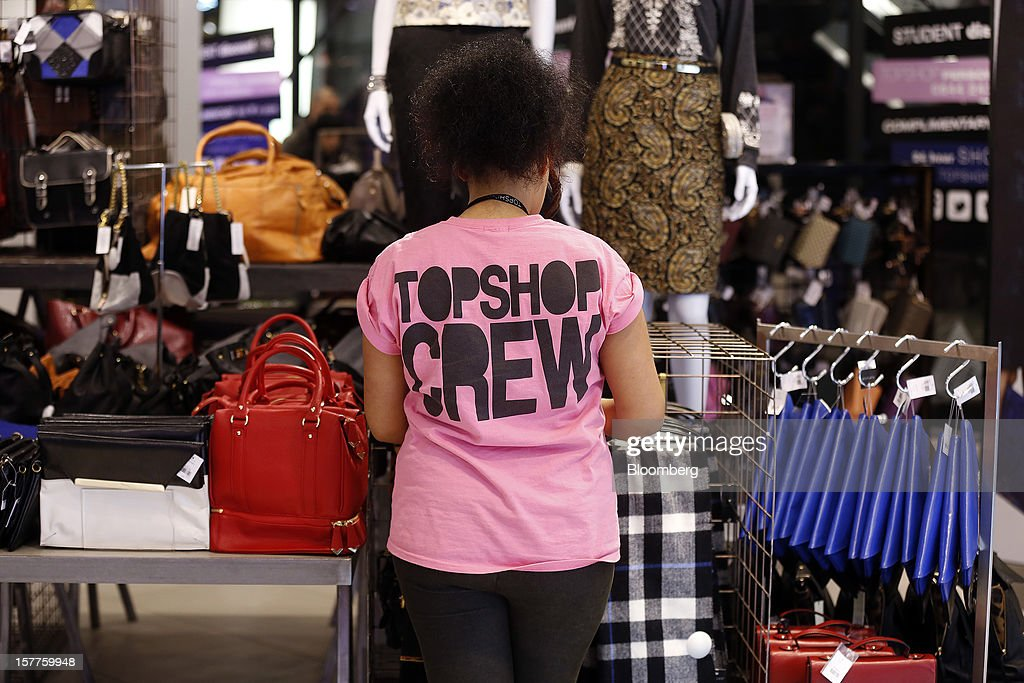 An employee tends to a display of women's bags inside a Topshop store, owned by Arcadia Group Ltd., on Oxford Street in London, U.K., on Thursday, Dec. 6, 2012. Philip Green, the billionaire owner of the Arcadia fashion business, sold a 25 percent stake in the Topshop and Topman retail chains to Leonard Green & Partners LP, the co-owner of the J Crew fashion brand, in a deal valuing the businesses at 2 billion pounds ($3.2 billion). Photographer: Simon Dawson/Bloomberg via Getty Images