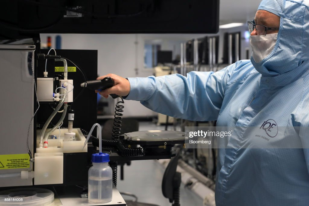 An employee tests a semiconductor wafer products in the 'clean room' laboratory at the IQE Plc headquarters in Cardiff, U.K., on Thursday, Sept. 28, 2017. IQE makes wafers that are needed for Vertical Cavity Surface Emitting Lasers (VCSELs), used for 3D sensors and widely thought to be included in the new iPhone. Photographer: Luke MacGregor/Bloomberg via Getty Images