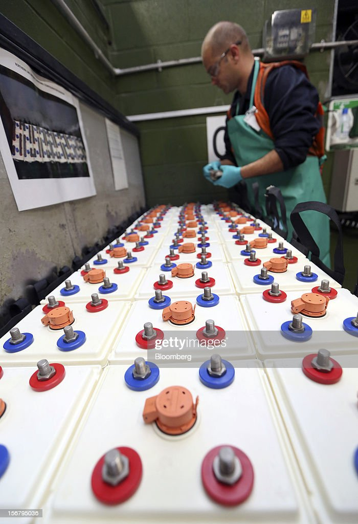 An employee tests batteries for London Underground Northern Line trains at Alstom SA's Traincare Centre in the Golders Green district of London, U.K., on Wednesday, Nov. 21, 2012. Transport for London (TFL), who oversee the U.K. capital's public transport system, issued 300 million pounds ($476 million) of bonds five months ahead of schedule to take advantage of investor demand as it continues its 35 billion-pound transport investment program. Photographer: Chris Ratcliffe/Bloomberg via Getty Images