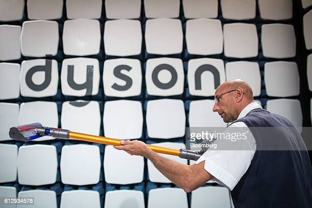 An employee tests the Dyson V8 cordfree vacuum cleaner in the EMC electronic compatibility room at the Dyson Ltd campus in Malmesbury UK on Wednesday...